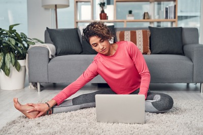 Woman Stretching and using laptop
