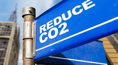 A street sign that reads reduce CO2.