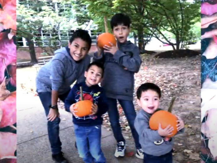Morales family children holding pumpkins - video screen shot of photo