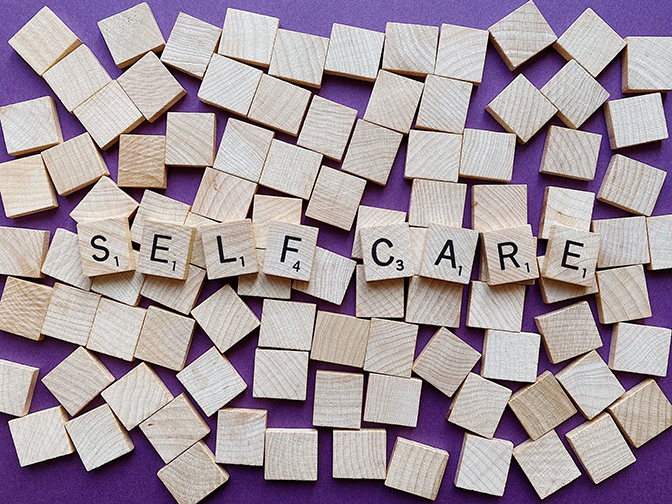 wood squares letters spell self-care