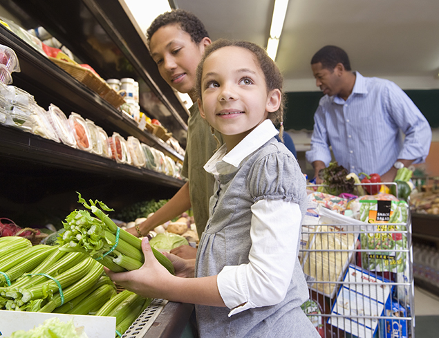 child at grocery store with two adults shopping