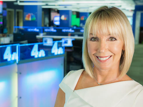 Susan Hogan in newsroom