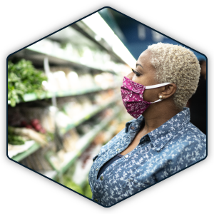 Woman wears face covering while grocery shopping