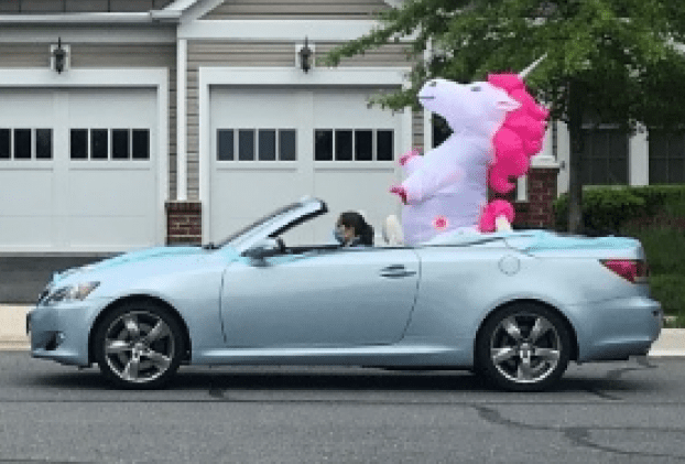 Convertable with giant inflatable unicorn  participates in Spring Hill N2N birthday parade