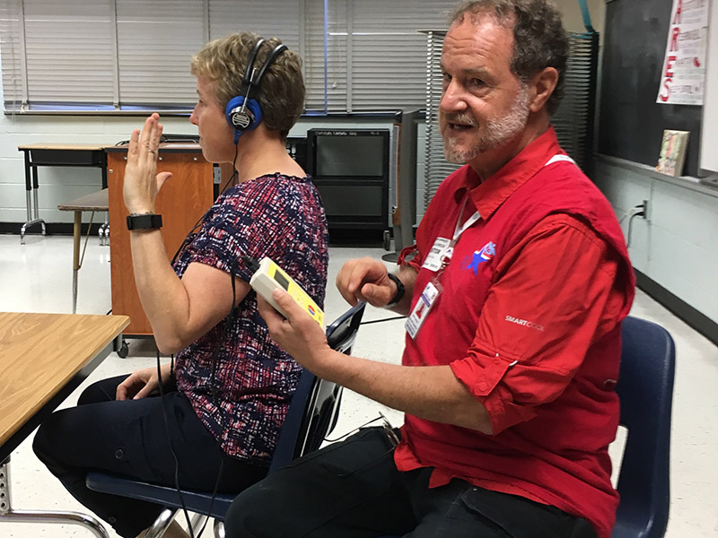 MRC volunteer conducts a hearing screening