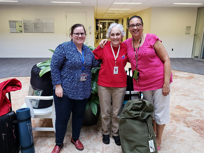 Carol Hutchinson, Janessa Deal and Fairfax Medical Reserve Corps volunteer Susan Jackson