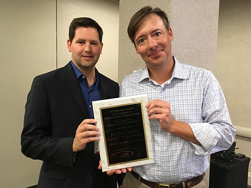 Health Department Public Information Officer John Silcox accepts Berreth Award
