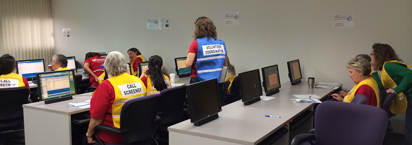 MRC volunteers in a computer lab completing Oracle training