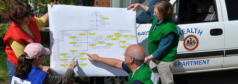 MRC volunteers look at an organizational chart