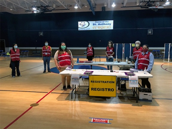 Medical Reserve Corps volunteers stand ready to help at a past vaccine clinic