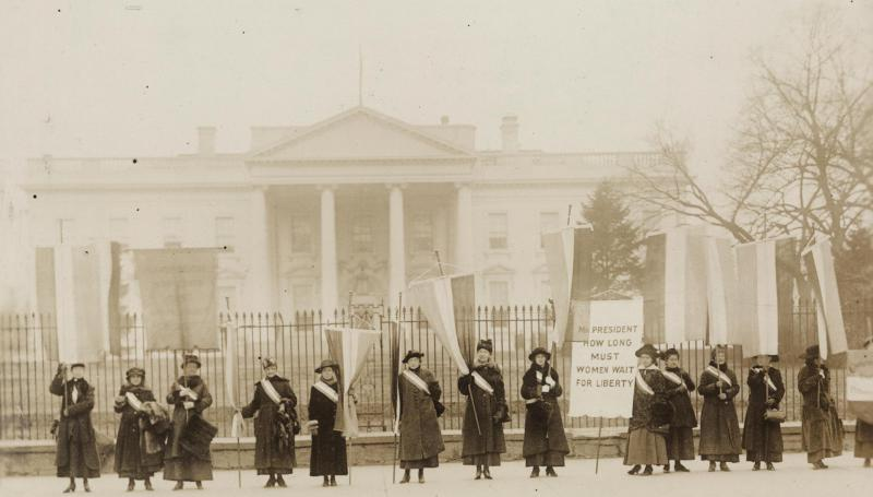 black and white photo of women picketing for the right to vote outside the White House in 1917
