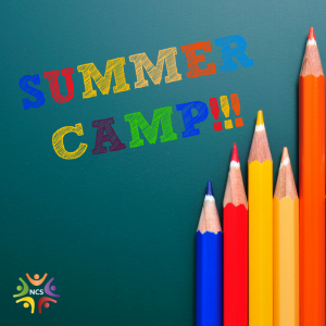 Image of a chalkboard that has Summer Camp written on it and three colored pencils lined up in front.