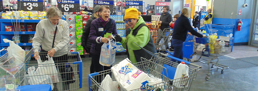 A Saturday shopper contributes to the Stuff The Bus effort