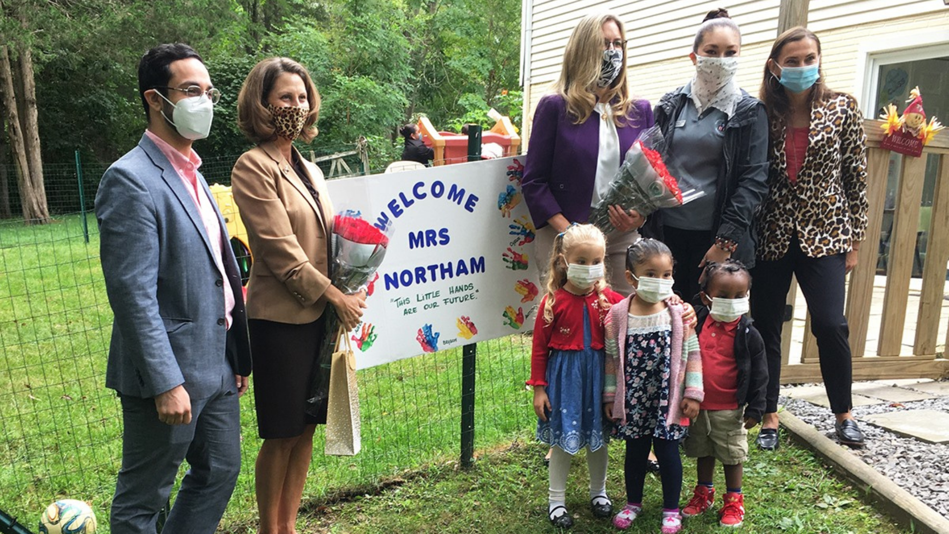 First Lady Northam stands with young children State Delegate Ibraheem Samirah, Congresswoman Jennifer Wexton and Senator Janet Howell's legislative staff.