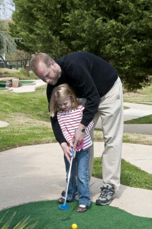 Father helping Daughter put at Jefferson Mini Golf