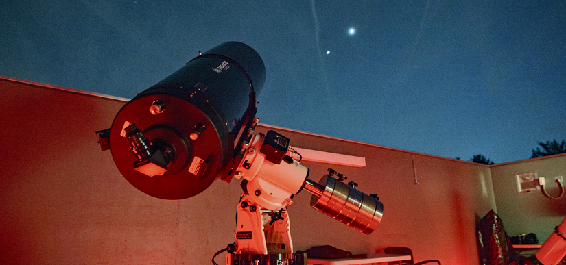 A telescope points into the sky at a distant star