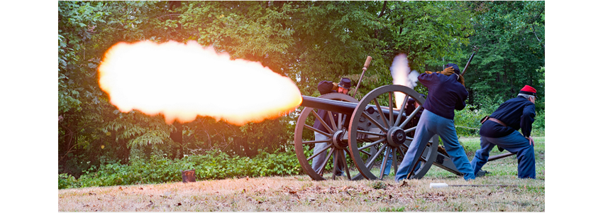 Civil War re-enactors fire a cannon