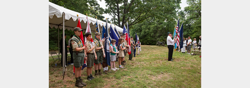 Scouts holding flags stand in line for the national anthem