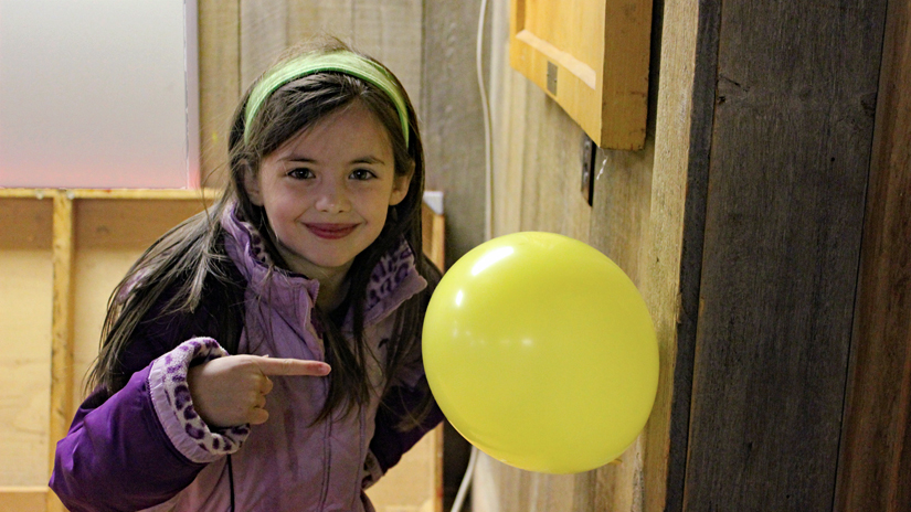 Girl Scout with balloon