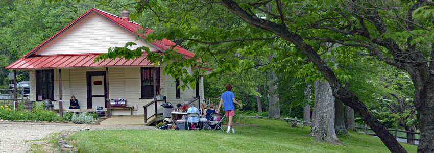 Picnickers sit outside Colvin Run Mill's General Store