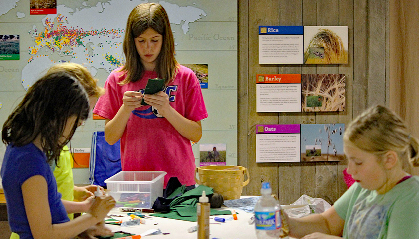 Girl Scouts work on an art program inside the Colvin Run Mill barn