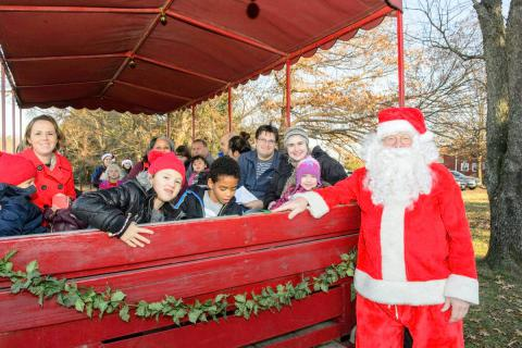 Go Caroling or Visit with Santa on a Wagon Ride in a Park