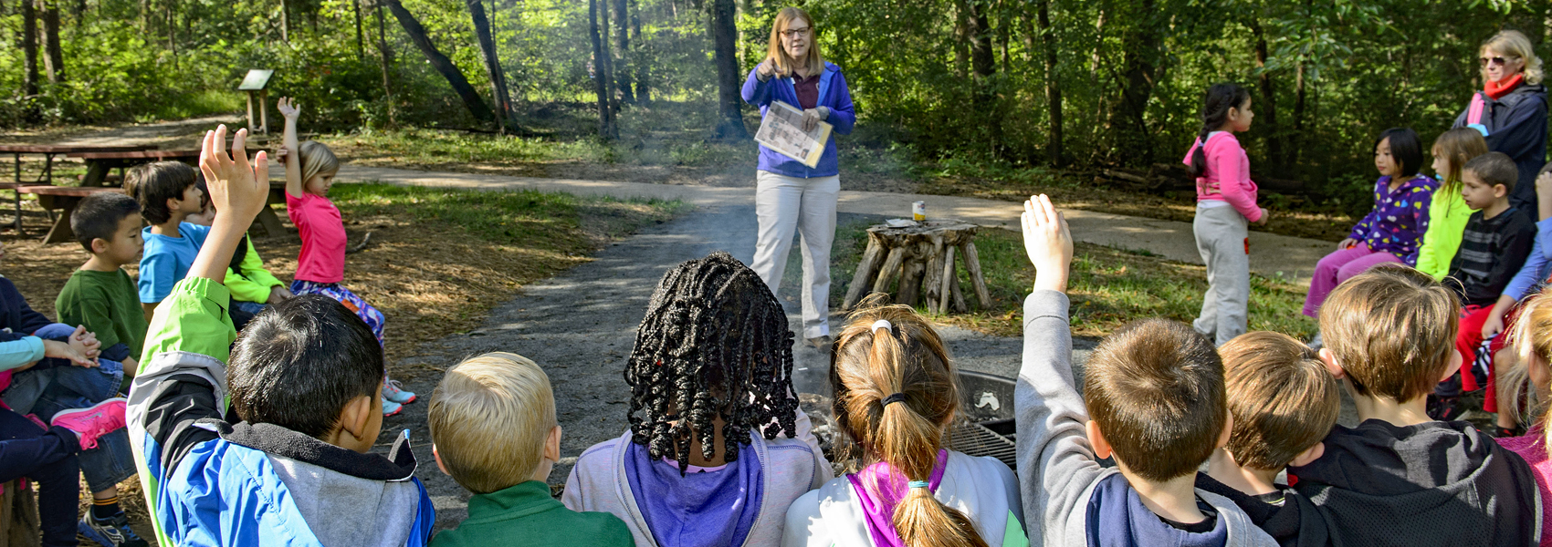 A naturalist talks to a group of students visiting the park