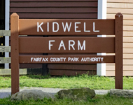 Kidwell Farm sign outside the farm's barn