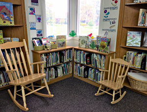 Two rocking chairs in a corner of Green Spring's library room
