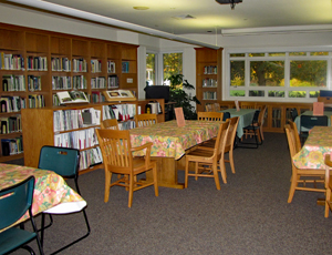 Tables and chairs arranged in rows in Green Spring's library