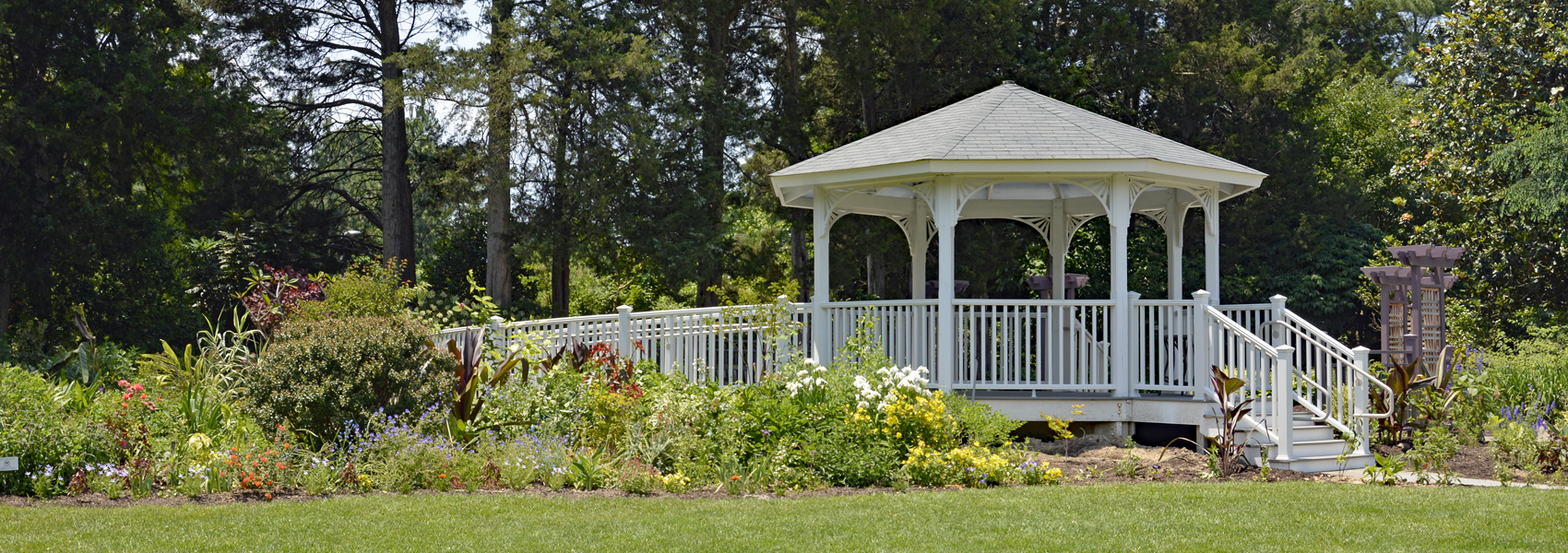 Flowers bloom around a gazebo