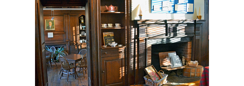 Fireplace, tables and knickknacks inside Green Spring's Historic House