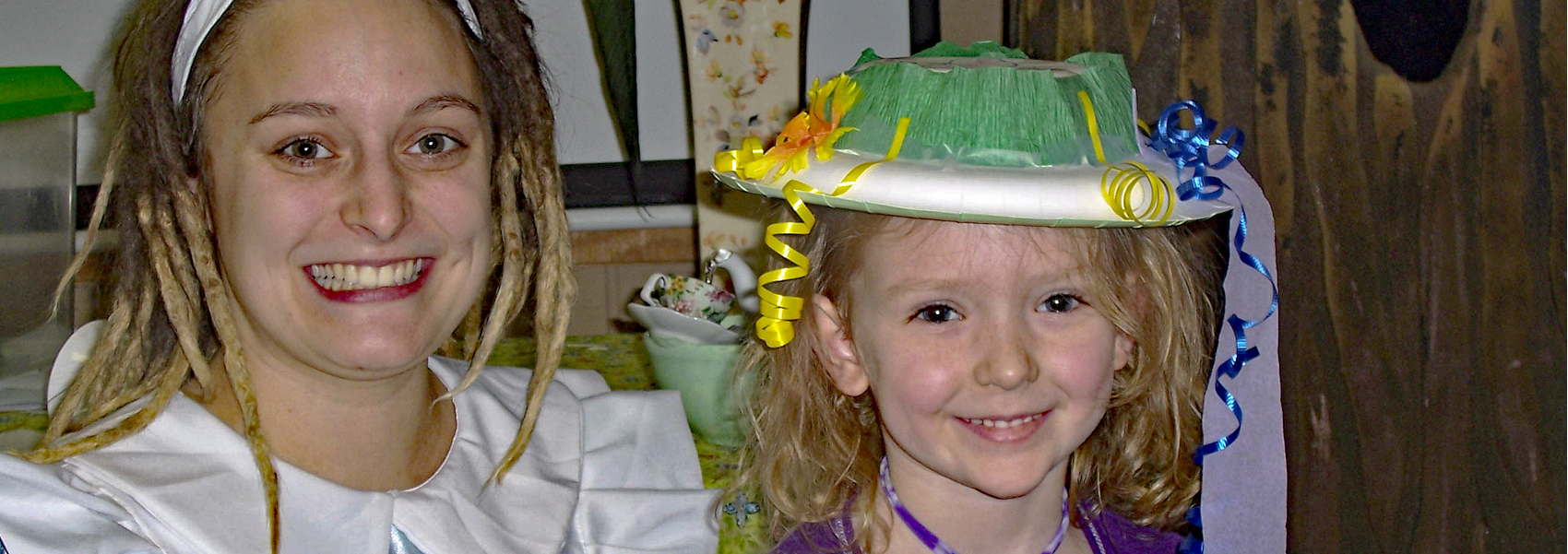 A young woman and young girl play dressup at Hidden Oaks