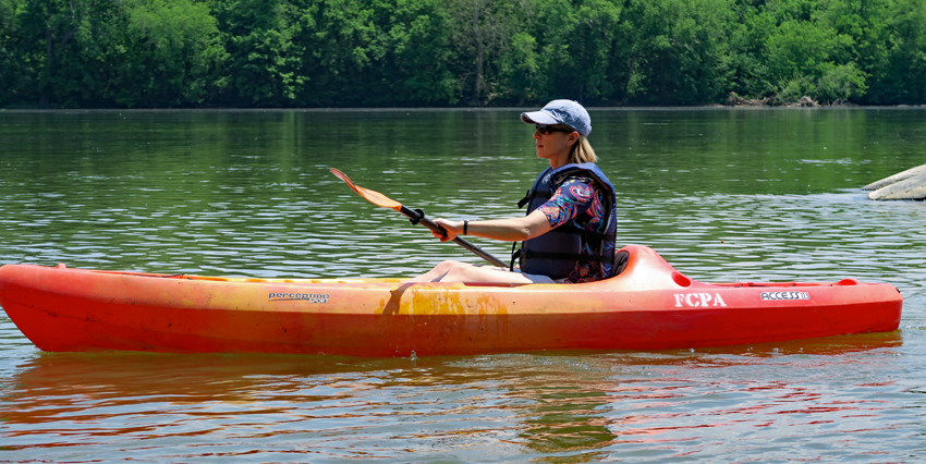 A woman kayaks on the Potomac River at Riverbend Park