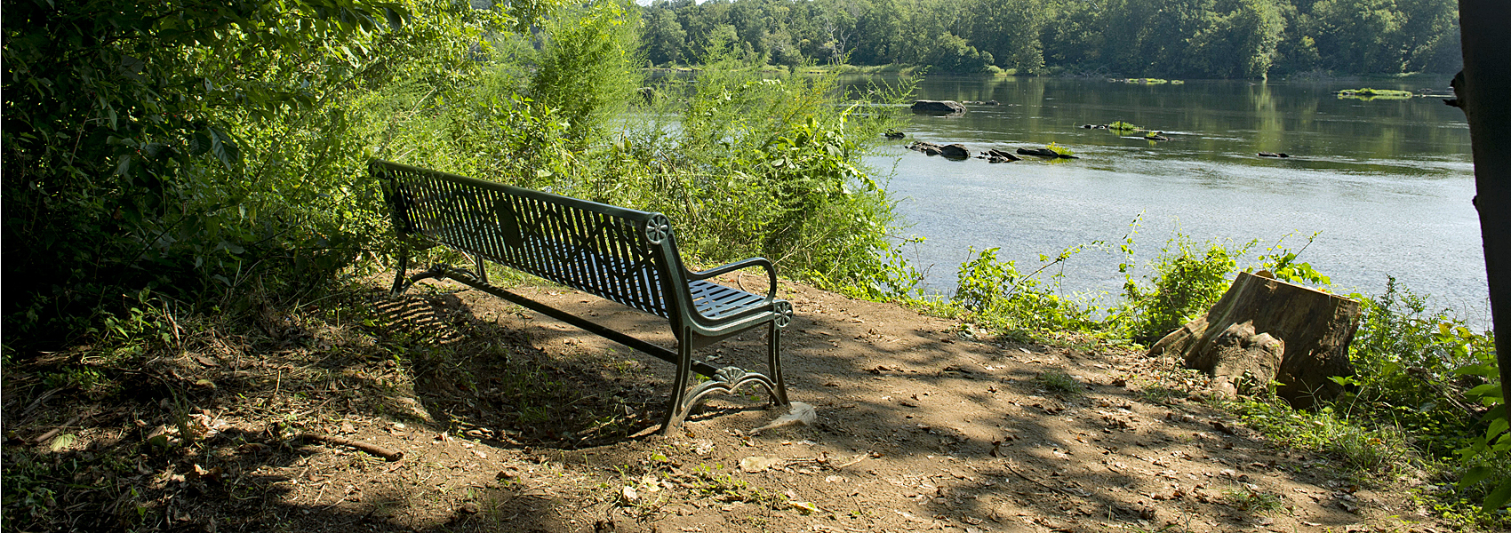 A bench sits in a viewing area alongside the Potomac River