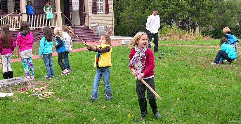 Girl Scouts take part in 18th century games on Sully's front lawn