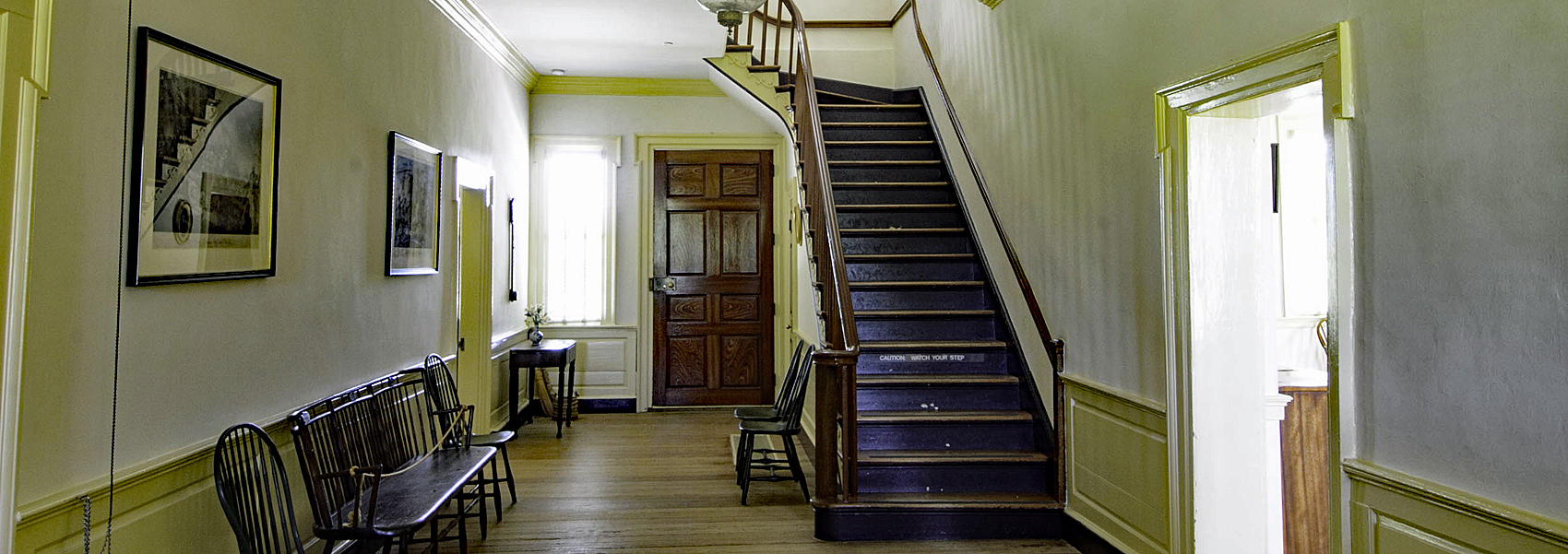 Hallway with stairs inside Sully's main house