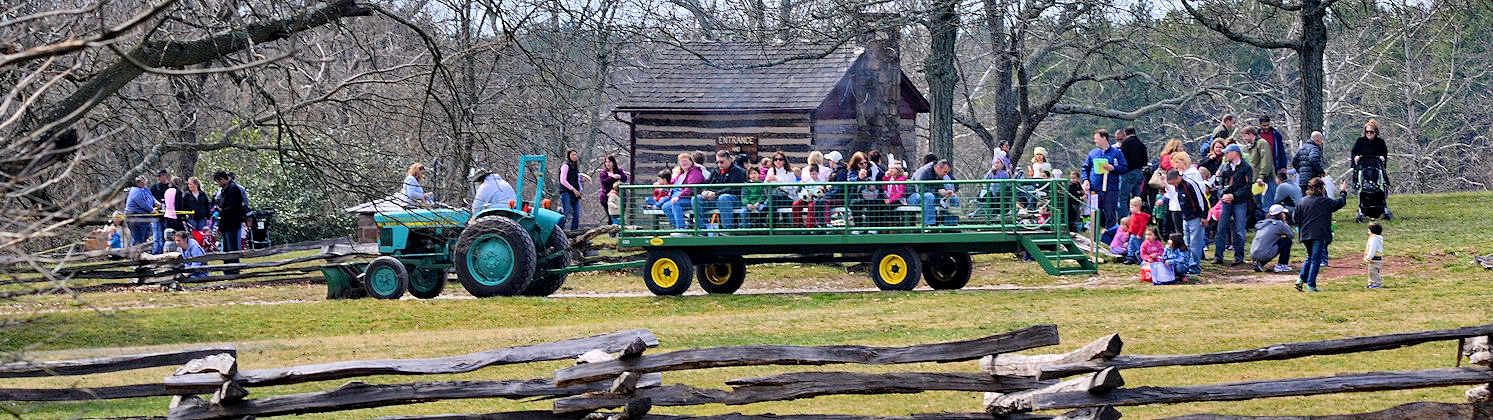 A large group of people on a wagon ride