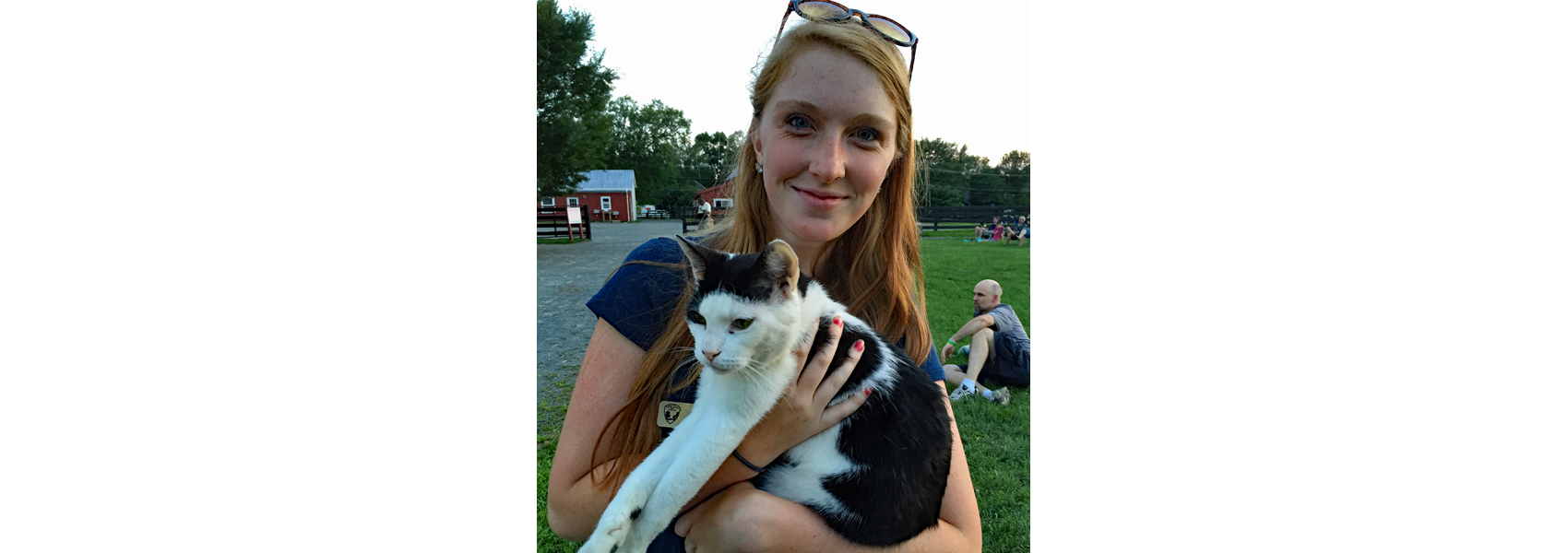 Volunteer at Frying Pan Farm Park holds a cat