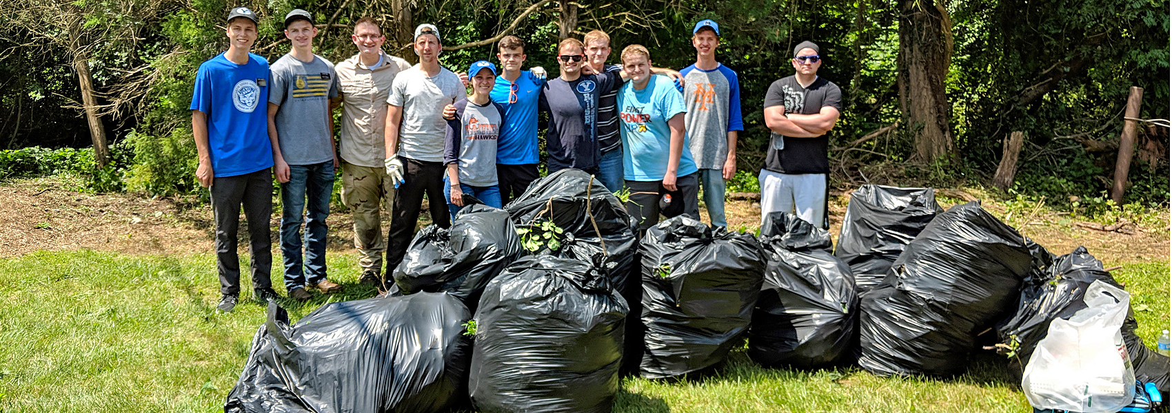 Park cleanup crew poses with about a dozen bags of trash