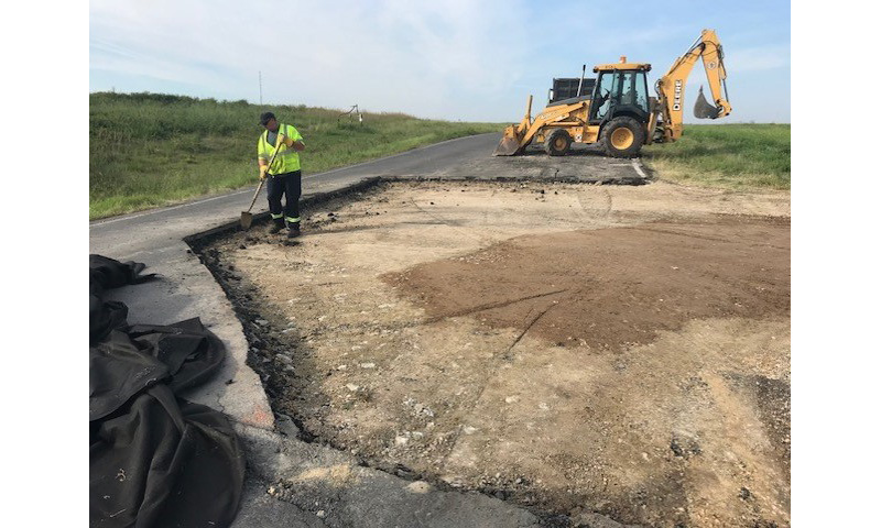Old asphalt is removed before a mix of recycled materials is used to repair the road.