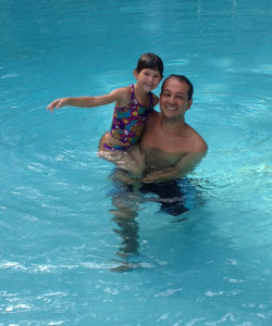 man and child in pool