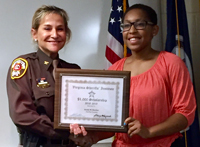 Sheriff Kincaid presents scholarship certificate to Sesaly Barden.