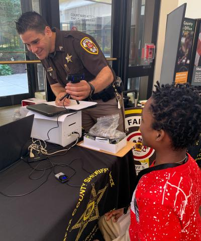 Deputy takes photo of boy for Child ID card