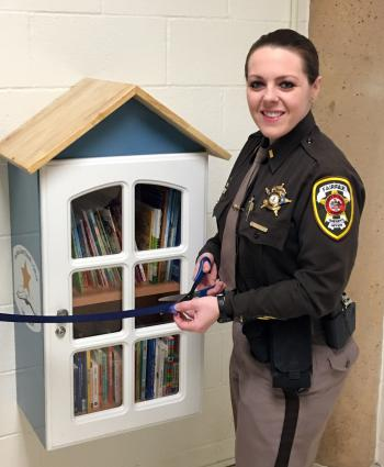 2nd Lt. Fary cuts ribbon on new Little Library