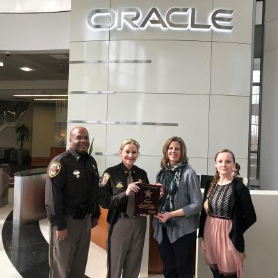 Sheriff Kincaid presents plaque to Gail Kolb at Oracle
