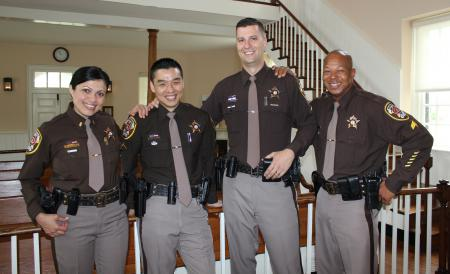 Four deputies in a courtroom