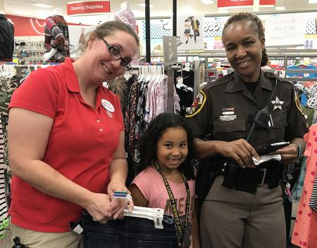 Sheriff'd deputy and Target employee with little girl