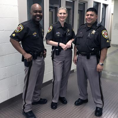Two male deputies and one female deputy