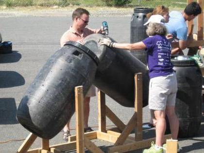 People building tumbler composters